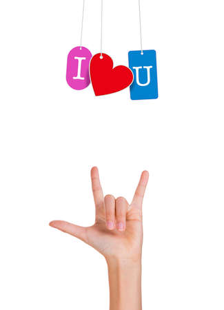 fingers on top: Hand with fingers forming love sign with I love you hanging tags, isolated white background with copy space on top Stock Photo