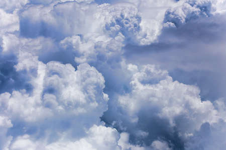 cotton cloud: Dramatic cloud formation with large fluffy cotton shape clouds on bright sunny day Stock Photo