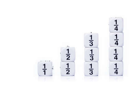 fraction: Stack up white fraction dices showing whole, half, third, and quarter numbers on white background with soft reflection