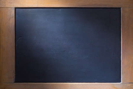 side lighting: Empty chalkboard background with wooden frame, side lighting for old style theme, good for using as an educational theme background