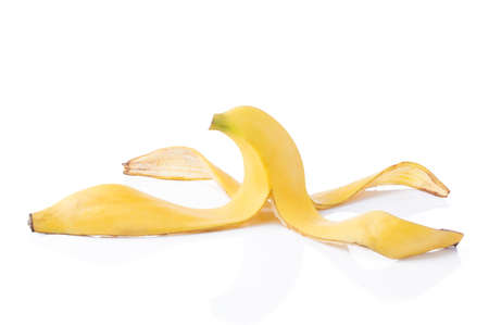 banana skin: Peeled yellow banana skin on white background with light shadow and reflection