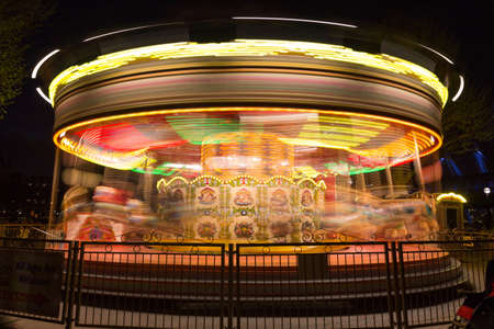 marry go round: merry go round, carousel, in motion at night, showing colorful lighting and movement Stock Photo