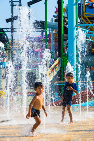 Pattaya, Thailand - 1 May 2016 - Two young asian boys enjoy playing with water on a bright sunny day at Cartoon Network Water Park, Pattaya, Thailand on May, 1, 2016 Editorial
