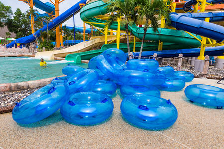 PHUKET, THAILAND - 8 JULY 2017 - Pile of Water floaters waits for people to use on water slide at Splash Jungle Water Park in Phuket, Thailand on July 8, 2017
