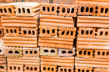Stacks of terra cotta bricks, good background for construction theme Stock Photo