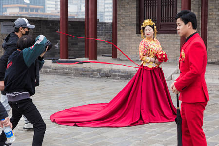 XIAN, CHINA - 10 March 2018 - Chinese photographer takes pre-wedding pictures for the couple on top of the Xian city wall in Xian, China on March 10, 2018