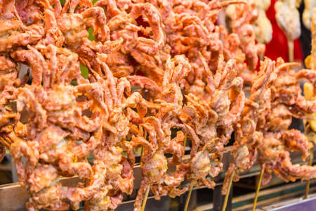 Deep fried soft shell crabs on stick, sale at Chinese Muslim Street market in Xian, China