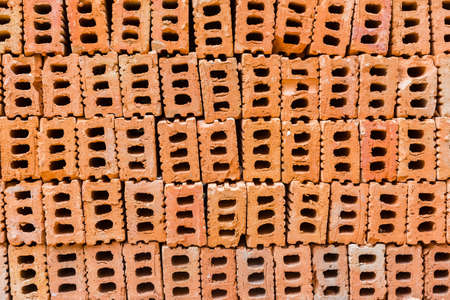 pile of construction bricks, showing holes in the middle