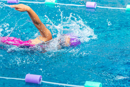 Young girl swimmer working on  her freeftyle swim at a local pool