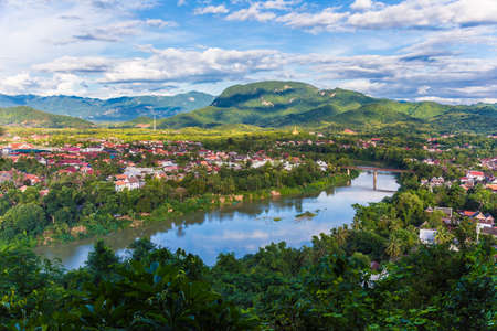 View of city along the Khan river of Luang Prabang, Laos, seen from the Phusri mountain