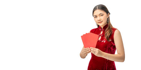 Happy beautiful young Chinese woman in red chinese dress holding red money envelopes against white background with copyspace