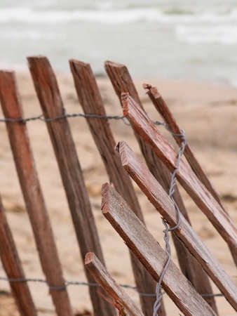 Snow fence falling down on Lake Michigan beach