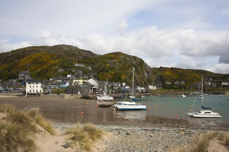 Barmouth harbour North Wales Located on the coast of North Wales, with a long sandy beach and a picturesque harbour bordered by the dramatically beautiful Mawddach estuary
