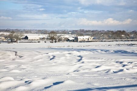 Farmland covered in a deep layer of snow Stock Photo