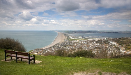 Hilltop view of Chesil beach, Dorset with the town of Fortuneswell in the foreground