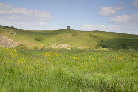 brean beach: View of the old 14th century tower which is the remains of a windmill on the hillside at Uphill near Weston Super Mare in Somerset Stock Photo