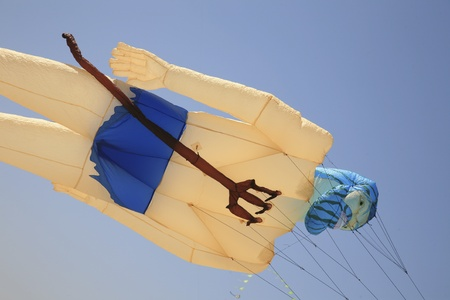 steep holm: A Neptune shaped kite flying in the sky Stock Photo