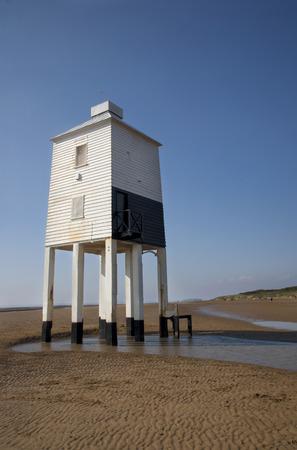 Wooden lighthouse on a beach