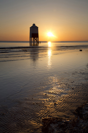 burnham: Sunset over the wooden lighthouse on Burnham on Sea beach in Somerset, UK Stock Photo