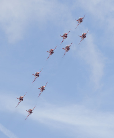 royal air force: WESTON SUPER MARE, UK - JUNE 21: Royal Air Force Red Arrows participate in the combined Air ShowArmed Forces event June 21, 2015 at Weston Super Mare, Somerset, England.
