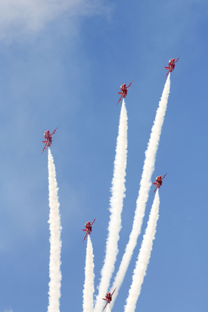 royal air force: WESTON SUPER MARE, UK - JUNE 21: Royal Air Force Red Arrows participate n the combined Air ShowArmed Forces event June 21, 2015 at Weston Super Mare, Somerset, England. Editorial