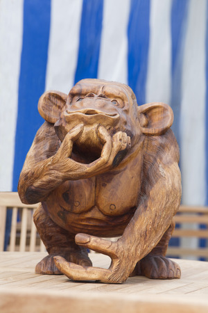 craftwork: A humerous carving of a monkey made out of wood