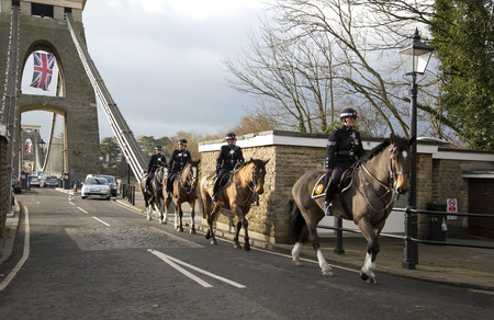 BRISTOL, UK - DEC 18: Mounted police crossing the Cifton suspension bridge on Dec 18 2014 in Bristol, UK