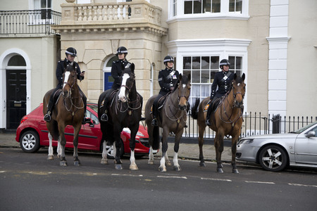 BRISTOL, UK - DEC 18: Mounted police standing outside buildings on Dec 18 2014 in Bristol, UK