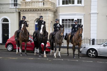 BRISTOL, UK - DEC 18: Mounted police standing outside buildings on Dec 18 2014 in Bristol, UK