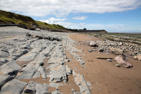 british weather: Doniford Bay consists of the Lower Jurassic Lias, and Triassic beds.The Jurassic lias at Doniford are the youngest of the lias at Somerset and marks the uppermost beds of the Lower lias. Stock Photo