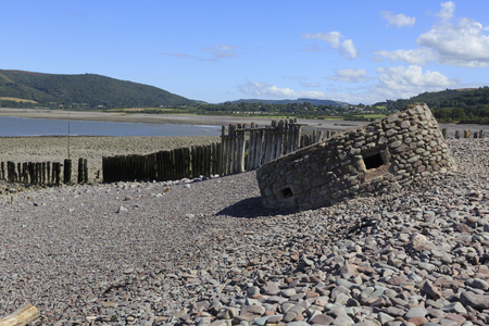 The remains of a World War II Type 24 pillbox overlooking Porlock Beach, polygonal in shape with five machine-gun loopholes. It may have been the command post for the area. It has partially collapsed.
