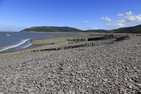 coastline at Porlock weir showing the old weathered breakers and the old sea defence building