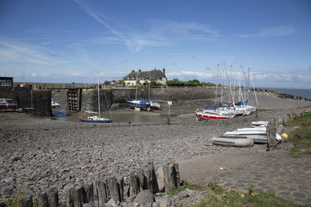 Boats and pretty cottages at Porlock weir in the county of Somerset on the west coast of the UK