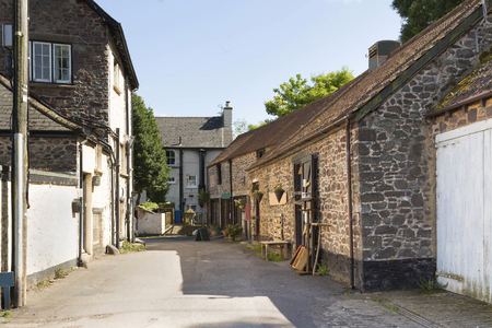 A view of old buildings in a harbour village backstreet in Somerset Stock Photo