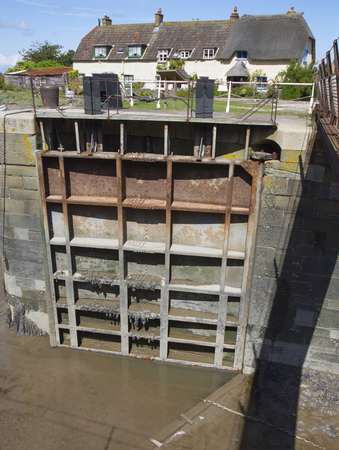 A lock gate at the pretty harbour at Porlock Weir in Somerset
