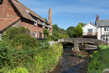 "old packhorse bridge: Allerford is a village in the county of Somerset, England, located within Exmoor National Park, and is part of the parish of Selworthy in the district of West Somerset. It appears in Domesday Book as ""Alresford – forda Ralph de Limesy Mill Stock Photo"