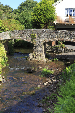 old packhorse bridge: Bridge over the stream in Allerford, Somerset, UK