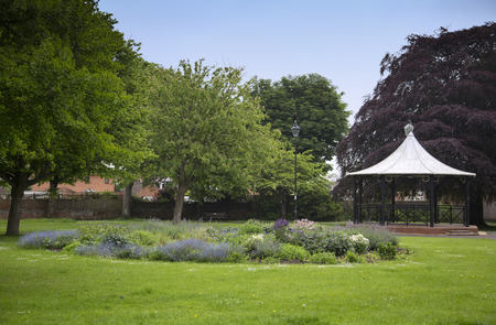 bandstand: A bandstand and a colourful flowerbed in a park