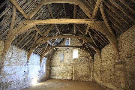 Old tithe barn in the village of Lacock in Wiltshire, UK