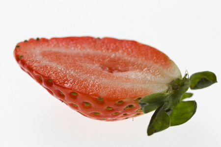 Tasty strawberry half isolated on a white background Stock Photo