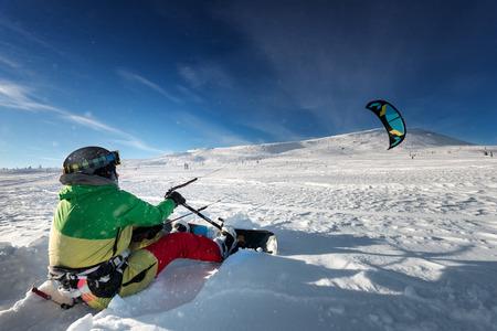 kiting: Snowboarder with kite on free ride. Sheregesh resort, Siberia, Russia