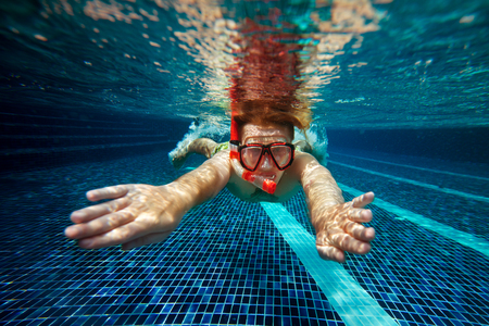 swim mask: Man with snorkel mask and tube swim underwater in swimming pool