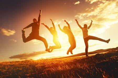 Teamwork success concept with group of jumping friends Standard-Bild