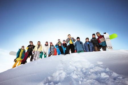 Group of friends skiers and snowboarders. Team friendship concept