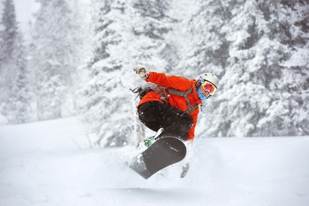 backcountry: Snowboarder jumps at Sheregesh backcountry freeride off-piste ski resort. Winter sports