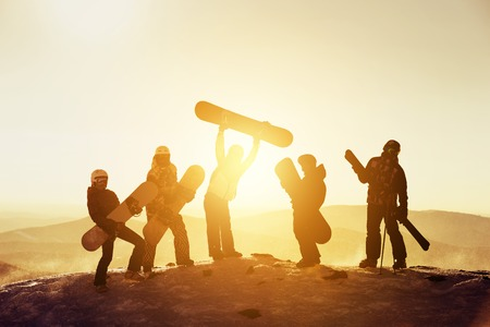 Group team friends ski snowboard skiers