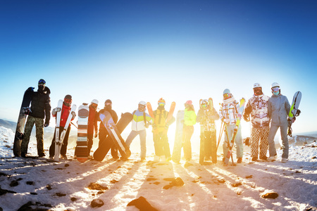 Group friends ski skiers snowboarders winter sports
