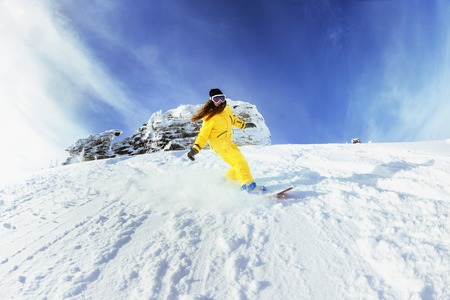 backcountry: Girl snowboarder backcountry fast snowboarding Stock Photo