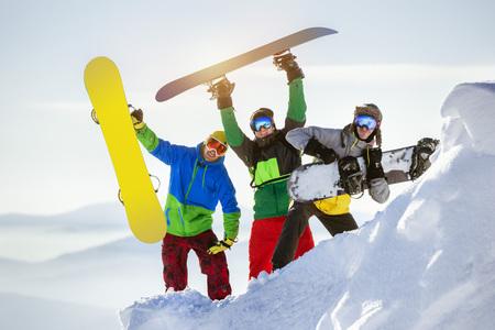 Group three happy snowboarders fun