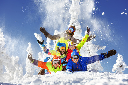 Group of five happy snowboarders and skiers Stock Photo
